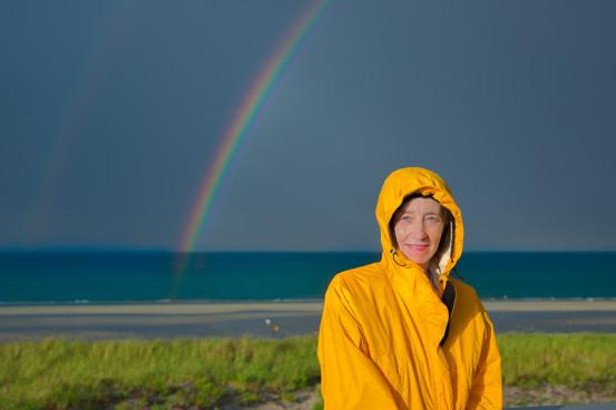 Woman on long beach rainbow