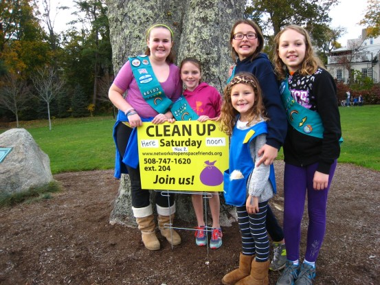 Local Girl Scouts cleaning alongside Town Brook