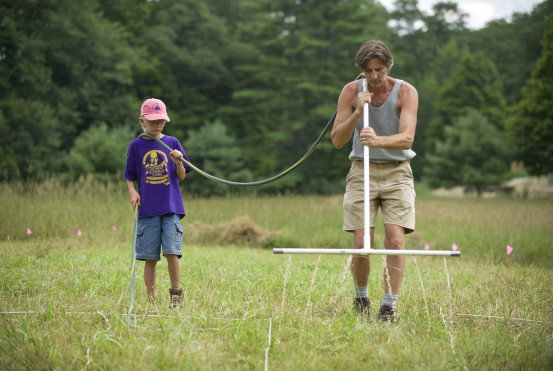Urine solution application by Konrad Scheltema and his son during field trials. Photo by Rich Earth Institute.
