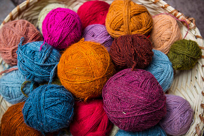 Balls of wool, or yarn, dyed with natural dyes, in Pisac Market, Peru.