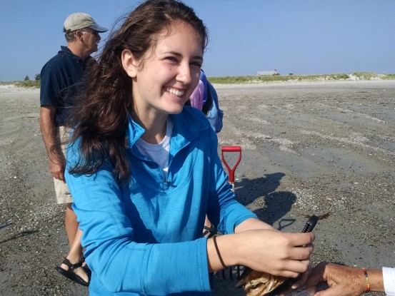 Jordan, a youth volunteer, teaches about clams